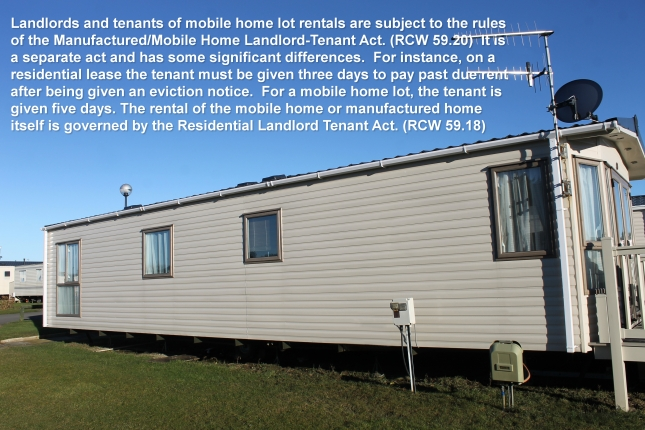 Exterior of modern trailer in caravan park, blue sky background.