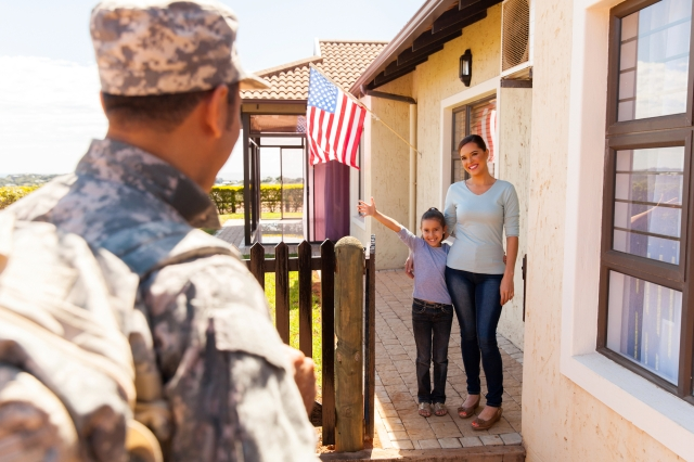 excited young american family welcoming military father returning home